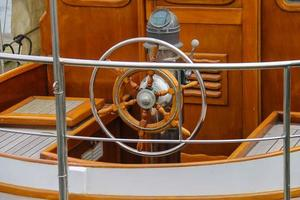 Steering wheel on the deck of a boat