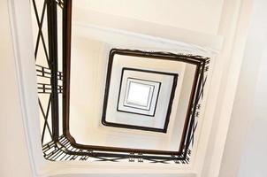 Square staircase perspective, view from below