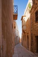 Ancient narrow street in Mdina, Malta.