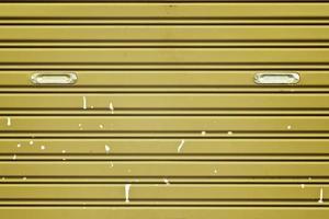 Dirty corrugated metal sheet slide door