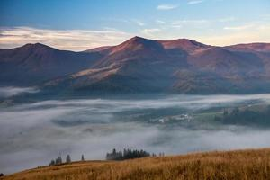 fog and cloud mountain valley landscape photo
