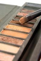 Bright eye shadows and brush close-up