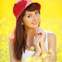Cute woman in the field with flowers photo