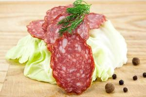 salami sausages on wooden board isolated photo