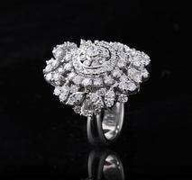 Diamond ring shot on a black reflective background