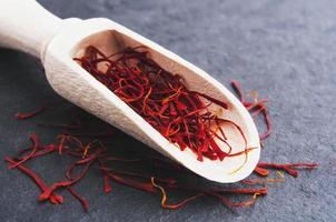 stigmas of saffron in wooden spoon