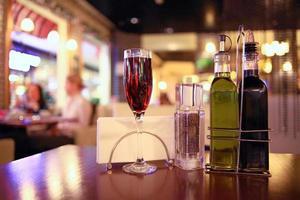 glass of wine restaurant interior serving dinner photo