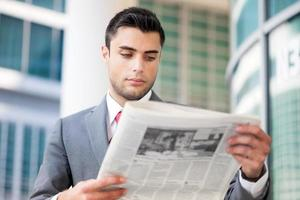 Business man reading a newspaper photo