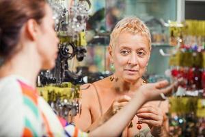 Women in a accessories boutique