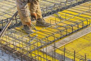 Builder worker Installing Steel Work 3