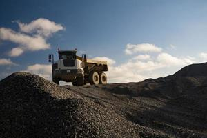 Dump Truck on the Pile of Gravel photo