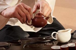 Young man holds a Chinese tea ceremony