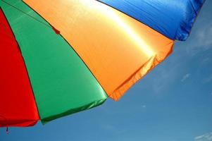 colorful umbrella tent with blue sky background