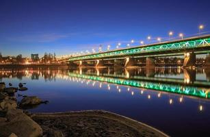 Highlighted bridge at night photo