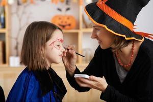 Applying Halloween make-up photo