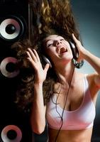Young lady with headphones on listening to music photo