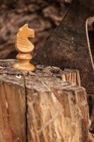 white chess piece, a horse and an ax photo