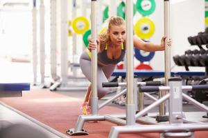 Woman working out using equipment at a gym