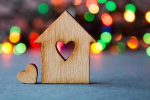 Wooden house with hole in form of heart with heart photo