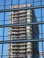 Building reflection in glass photo