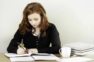 Worried student writing hard photo