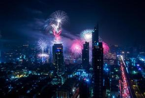 Cityscape of Bangkok at night during firework celebration