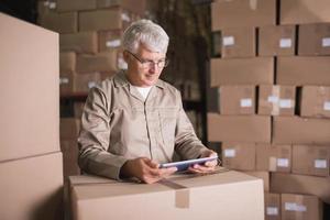 Warehouse worker using digital tablet