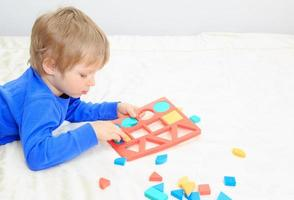 little boy learning shapes photo
