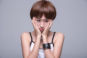 Asia women show boring mood photo