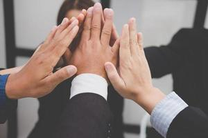 businessman joining hand, business team touching hands together - unity, harmony, teamwork, partnership, collaboration, corporate concept.