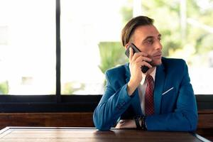 Portrait Of Italian Businessman Sitting In Coffee Shop photo