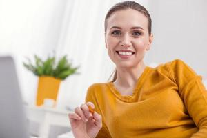 Adorable female freelancer starting work photo