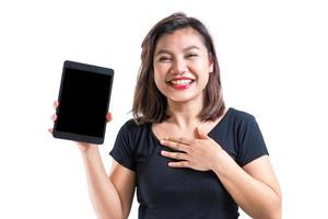 Young asian woman presenting blank screen tablet, with joy and cheerful emotion, for mobile or tablet application advertisement, isolated, white background