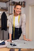 Happy young fashion designer