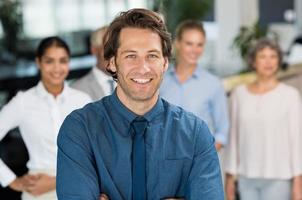 Smiling businessman with colleagues