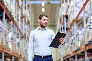 businessman with clipboard at warehouse photo