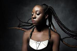 Black woman with the flying braided long hair