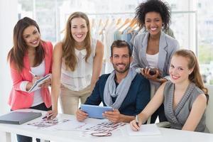 Fashion designers discussing designs photo
