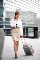 young businesswoman talking to mobile
