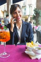 Young Businesswoman Talking on Mobile Phone during a Break