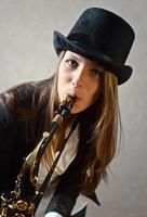 young beautiful woman with saxophone photo