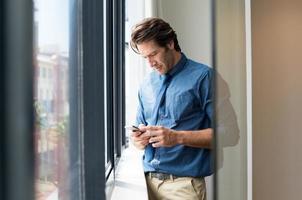 Businessman texting a message