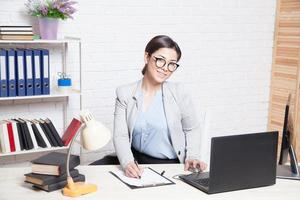 business girl works at a computer in the Office photo