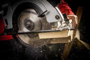 Carpenter with Circular Saw photo