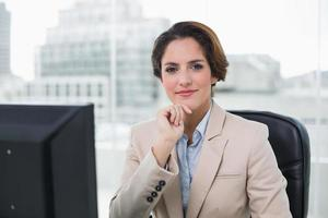Content businesswoman smiling at camera