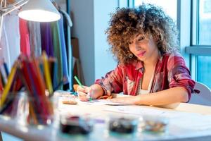 Young fashion designer working on new design. photo