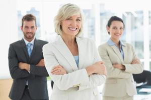 Confident business team with arms crossed in office photo