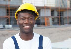 Portrait of an african american construction worker at building site photo