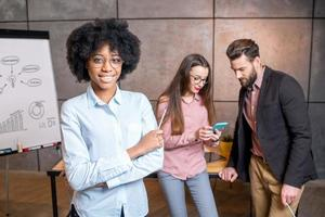 Woman's portrait with coworkers photo