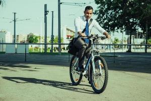 Young Latin Office Employee Riding Bicycle to Work